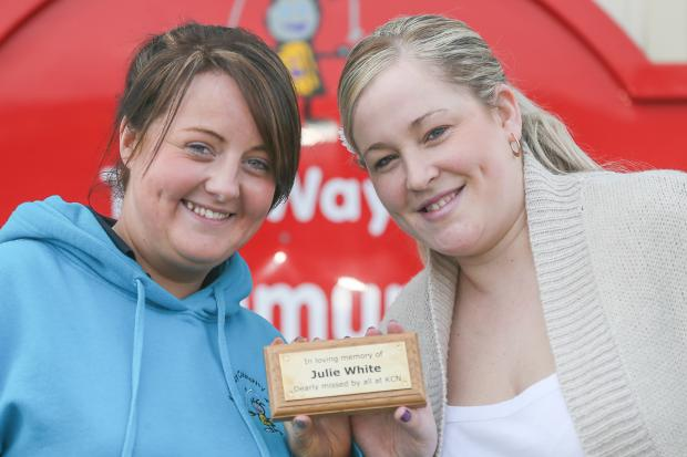 Senior nursery nurse, Laura White, and room leader Vickki White, with the plaque in memory of Julie White