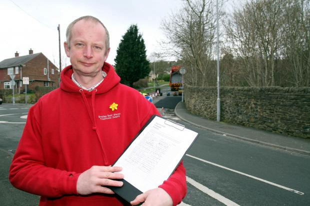 Shopkeeper David Mortimer with his petition pleading for safety improvements near Oakbank School