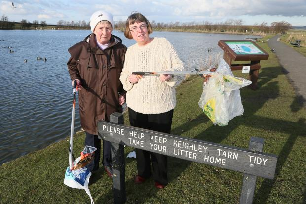 Dorothy Tennant and Councillor Jan Smithies are appealing to people feeding birds at Keighley Tarn to take their rubbish home as it has been blowing into the water