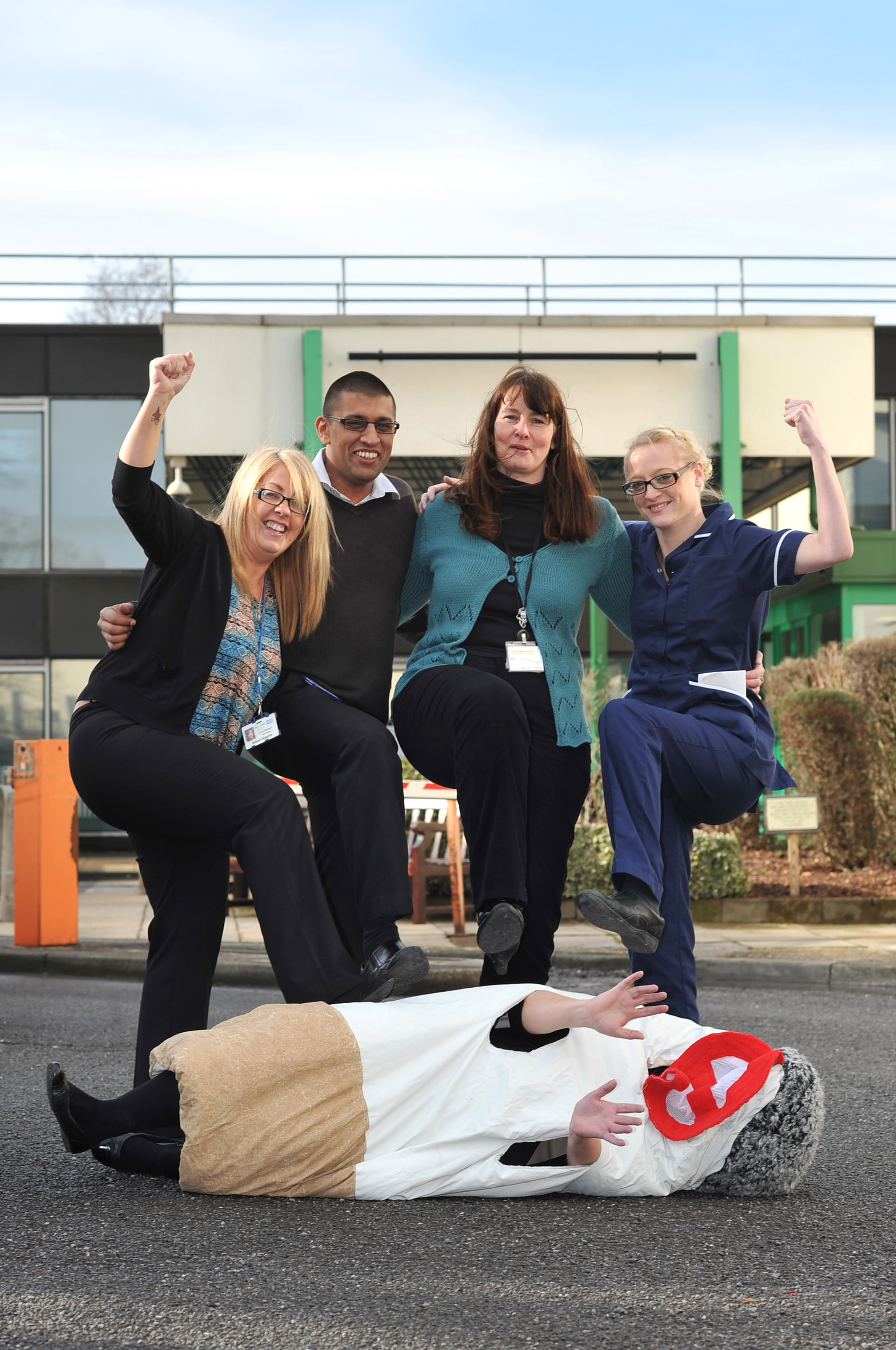 Medical secretary Alison Higgins, Shahid Rashid, of the IT helpdesk, stop-smoking adviser Amanda Bailey and Catherine Bramley, ward manager of the ambulatory care unit, help kick the habit