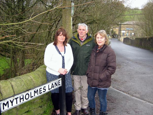 Oakworth residents Margo Avill-Lee, Richard Walker and his wife, Jan Walker, are angry plans have been approved for a lorry park beside the famous Railway Children Walk