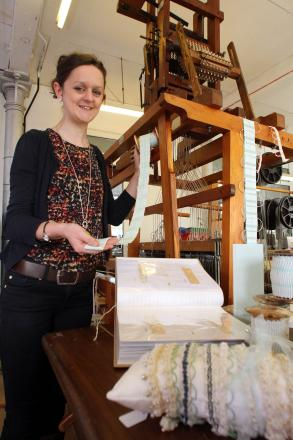 Lily Tennant with some of the hand-woven trims being produced at Wydean Weaving
