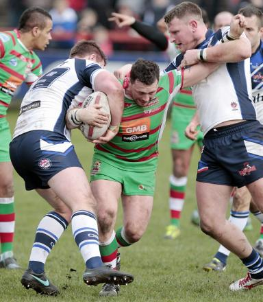 Ash Lindsay drives the ball forward for Keighley Cougars in their heart-breaking defeat against Leigh Centurions. Picture: Charlie Perry