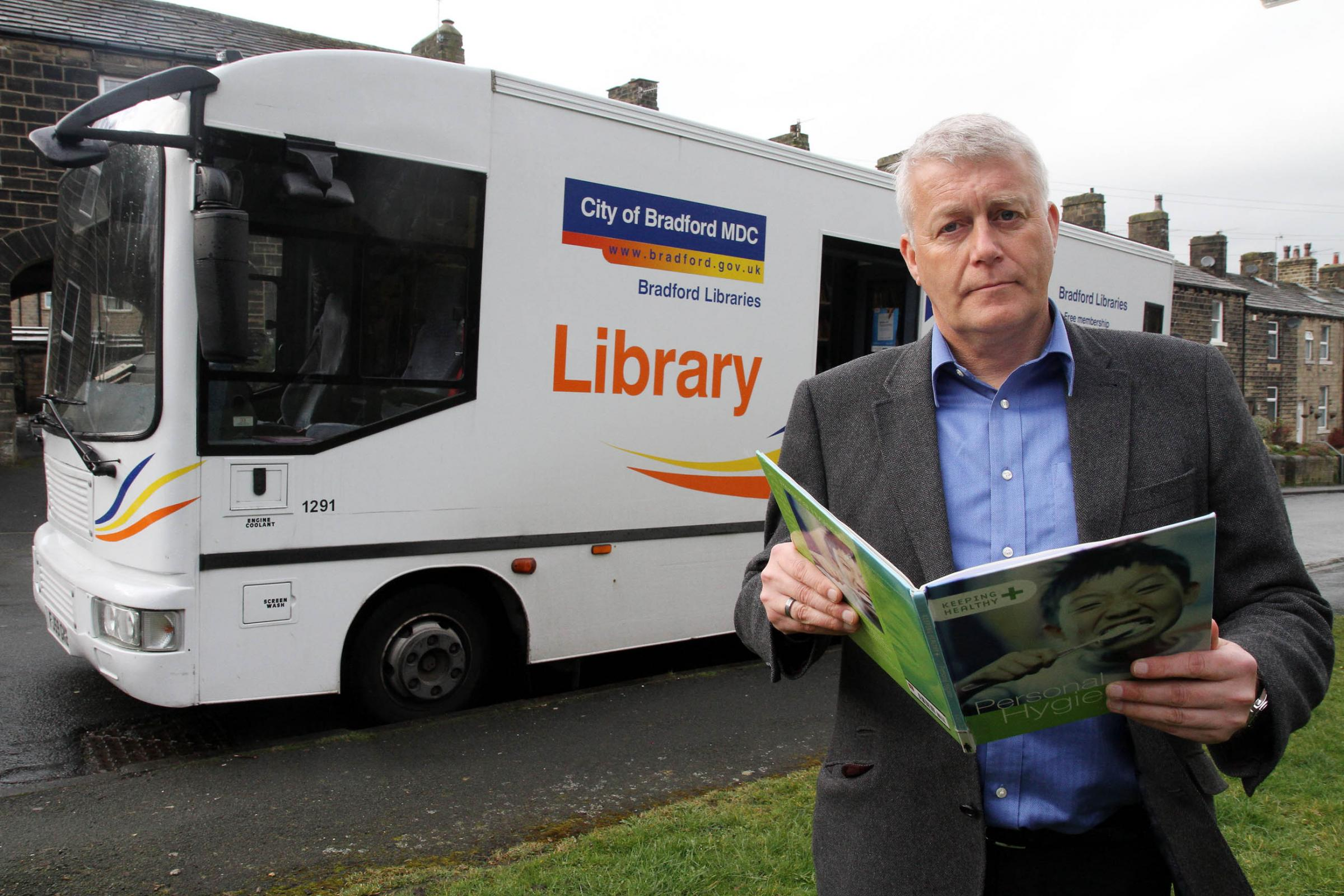 Councillor Andrew Mallinson stands beside the Bradford Council mobile library during a visit to Steeton ahead of the service being axed