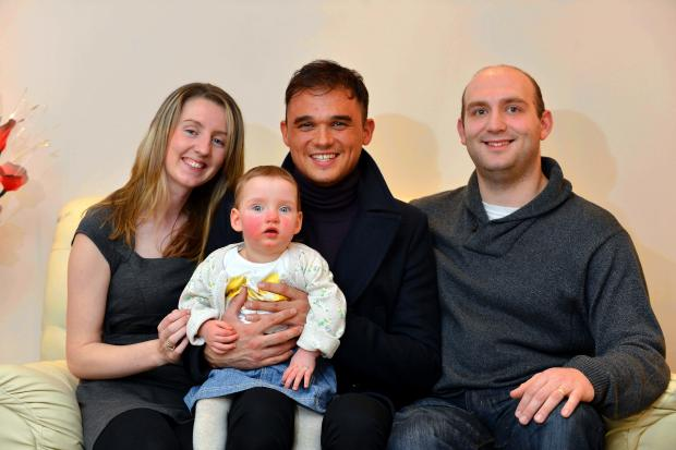 Little Nicole  gets a hug from pop star Gareth Gates with, from left, and her mum and dad