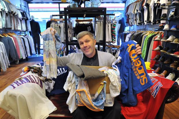 Keighley News: Mark Dale, of Pink V Blue, donates surplus stock to the British Heart Foundation store in Keighley's Airedale Shopping Centre, where his shop is located