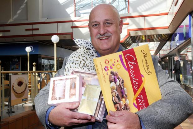Airedale Shopping Centre manager Steve Seymour with some of the Mother's Day competition prizes up for grabs