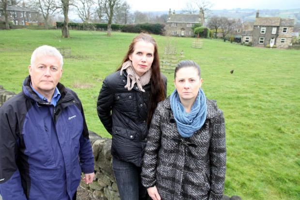 Keighley News: Councillor Andrew Mallinson joins Eastburn residents Kirsty Tudor and Victoria Lakin at the site of planned new housing in Eastburn