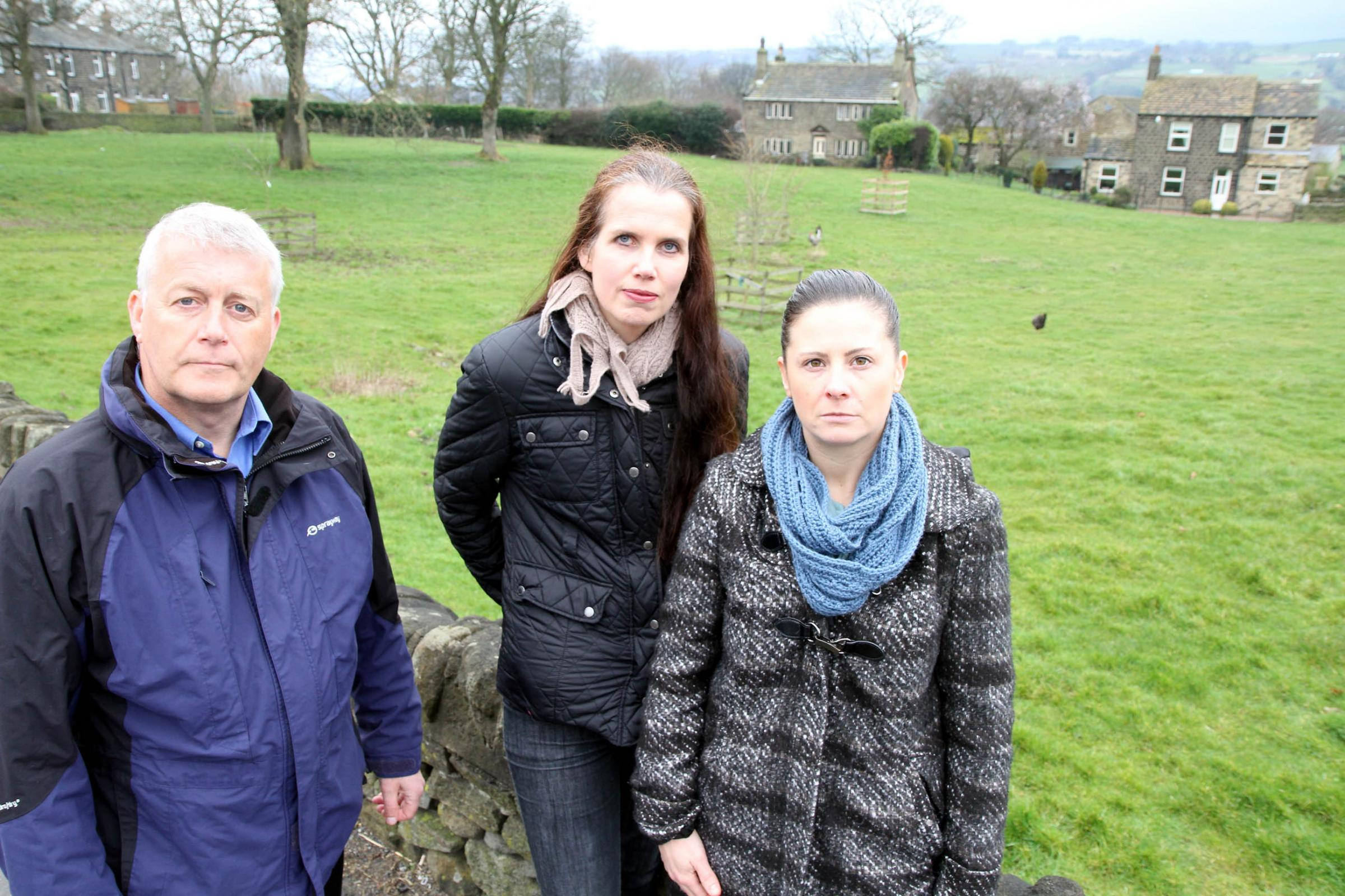 Councillor Andrew Mallinson joins Eastburn residents Kirsty Tudor and Victoria Lakin at the site of planned new housing in Eastburn