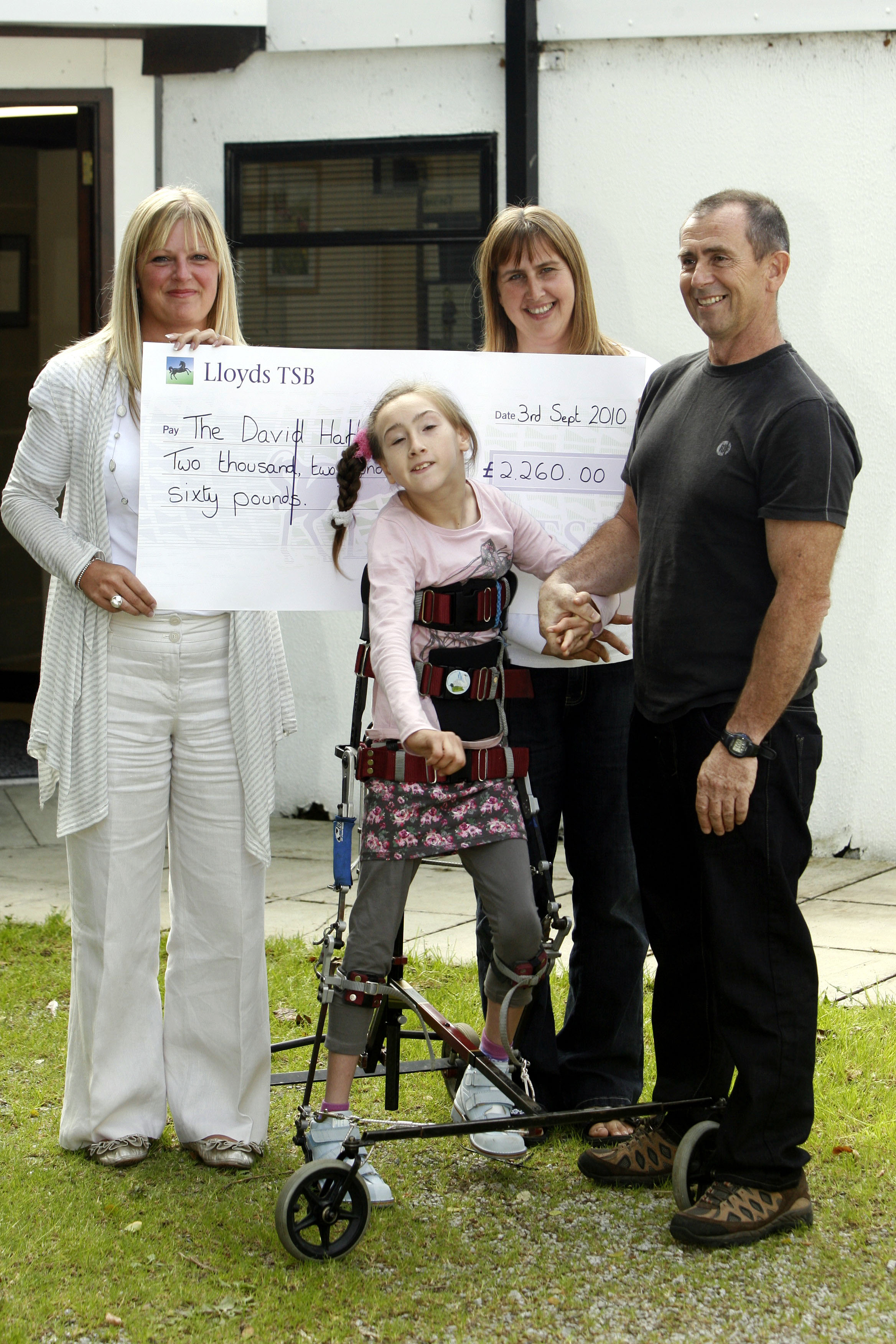 Natasha Lambert, then aged 13, when she visited the David Hart Clinic with her mum and dad, Amanda and Gary