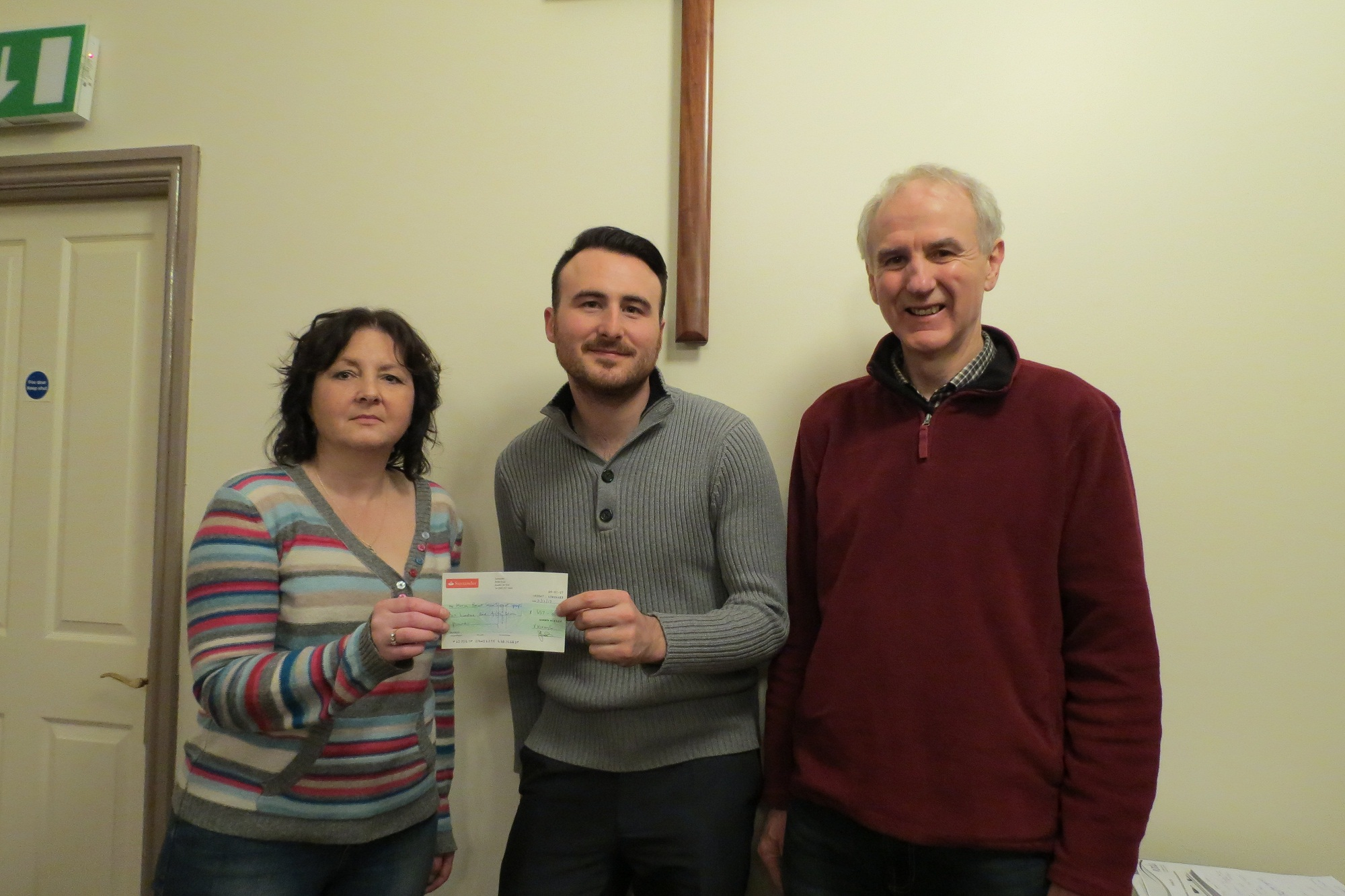 l Tom Robertshaw, senior fundraiser for Haven, is pictured (centre) receiving a cheque from Rebekah Day and society chairman Ron McGill, representing proceeds of the raffle held by Haworth West Lane Baptist Amateurs during their production of Princess Ida
