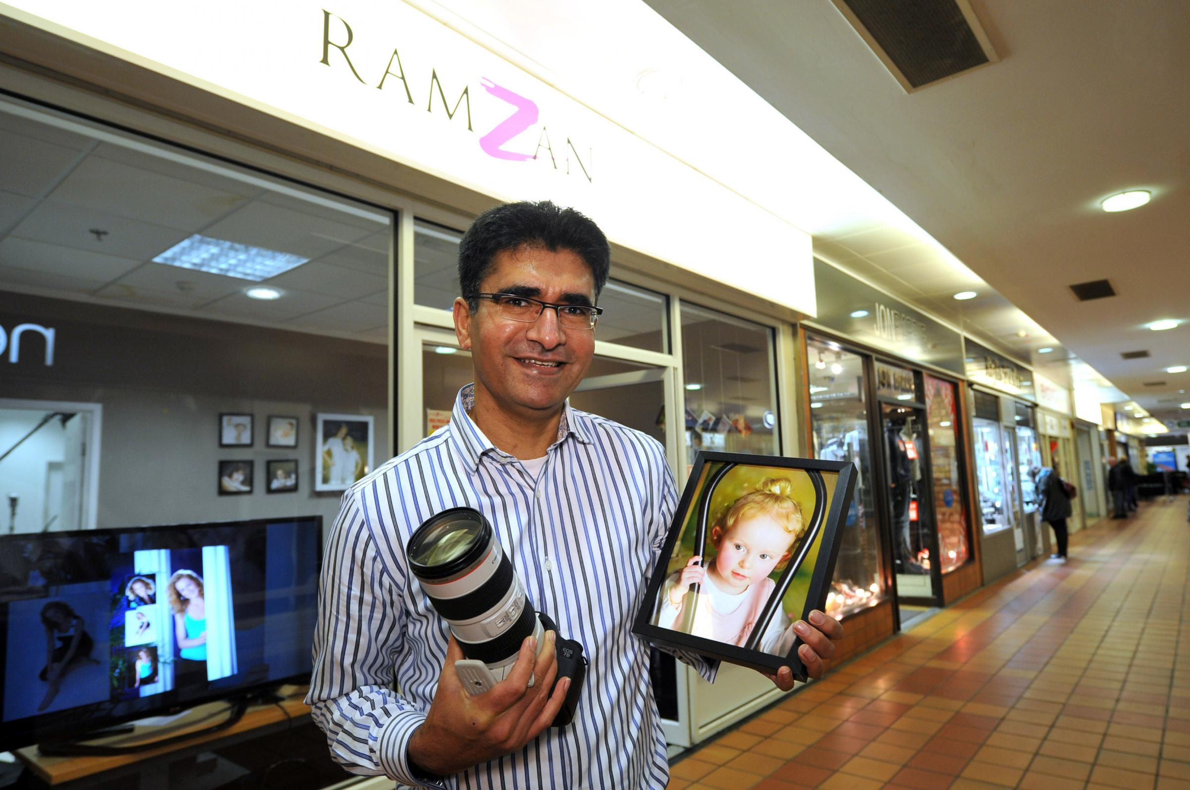 Akhtar Ramzan, of Ramzan Photographics, opens up his new shop in the Brunswick Arcade at Keighley's Airedale Shopping Centre