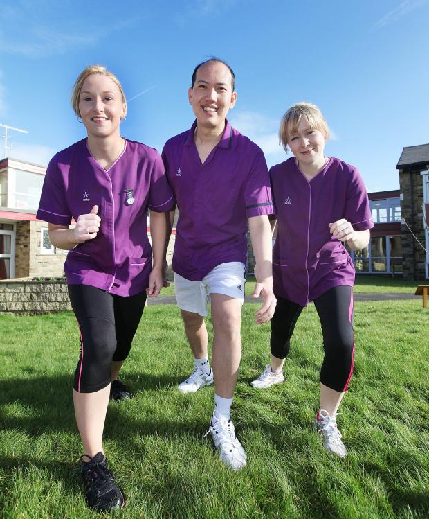 Keighley News: Townend Close Nursing Home staff Sharon Sorsby, Alvin Cruz and Donna Ashton in training for the Keighley BigK 10K in aid of Manorlands