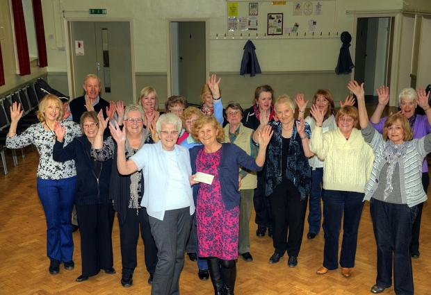 Keighley News: ulie Blackburn, front right, a sister on the Airedale Hospital endoscopy unit, with members of the dance group