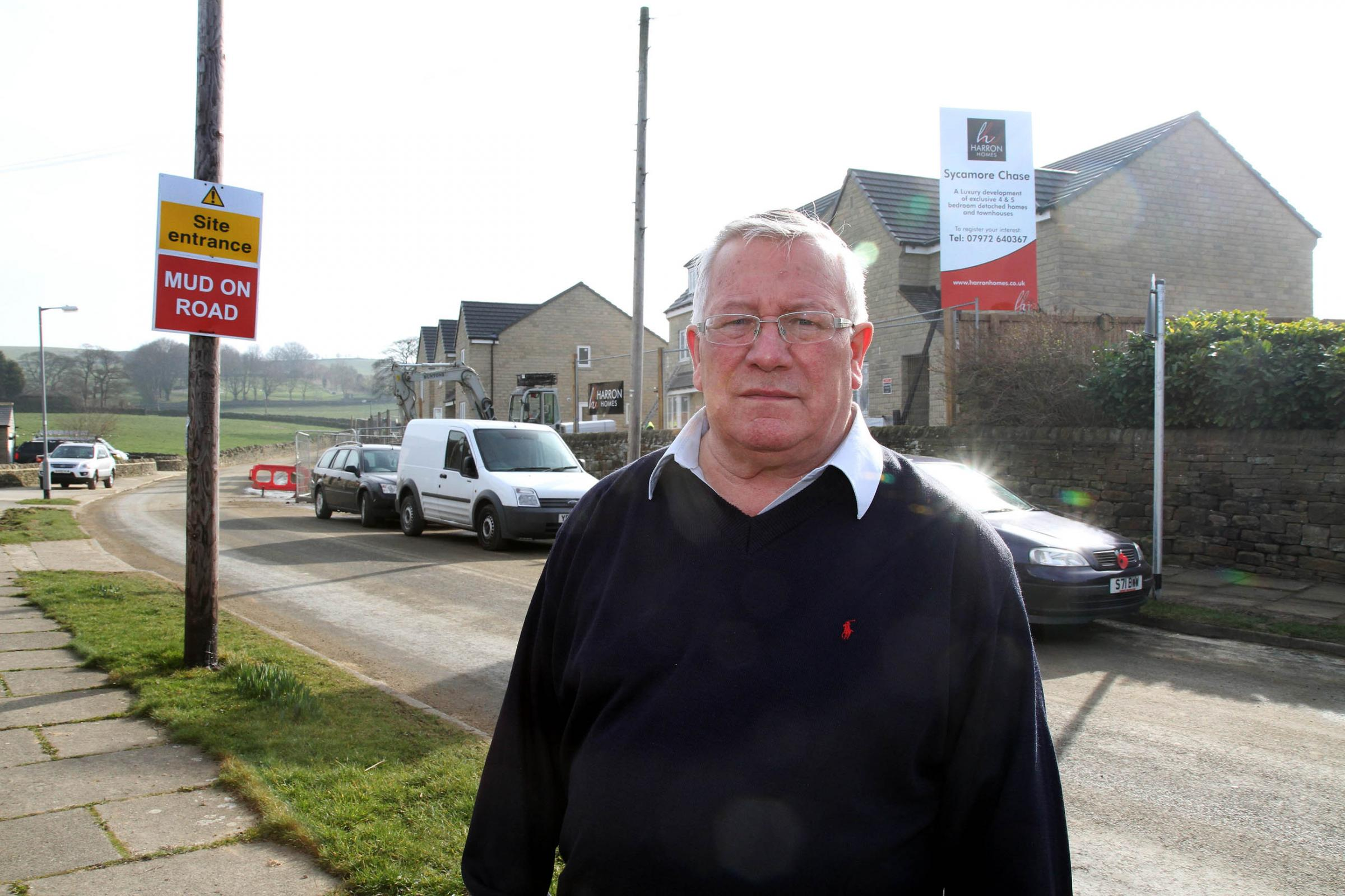 Councillor Mike Ellis in Crack Lane, Wilsden,where Harron Homes are building 82 new houses