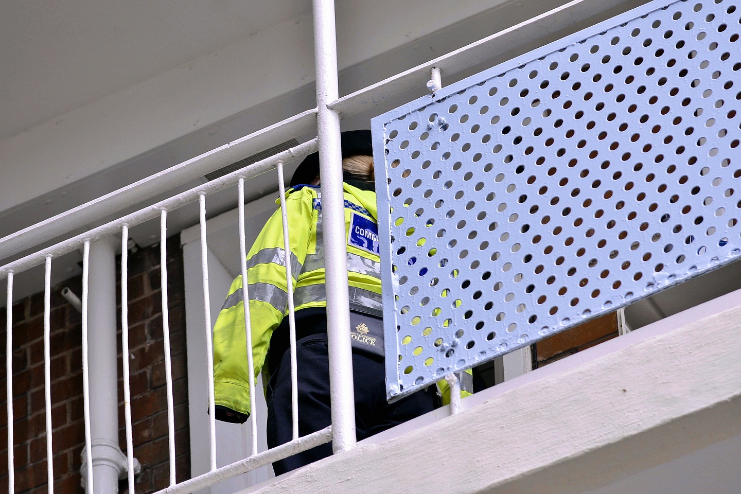 A PCSO stands guard at Gerard House, Fairhaven Green, Thorpe Edge, where the assault took place at the weekend