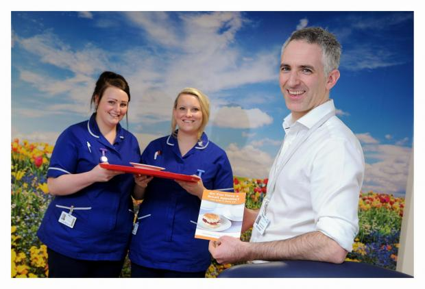 Keighley News: Airedale NHS Foundation Trust staff nurses Lucy McDonnell, left, and Paula Bolland with nutrition support dietician, Nick Bergin