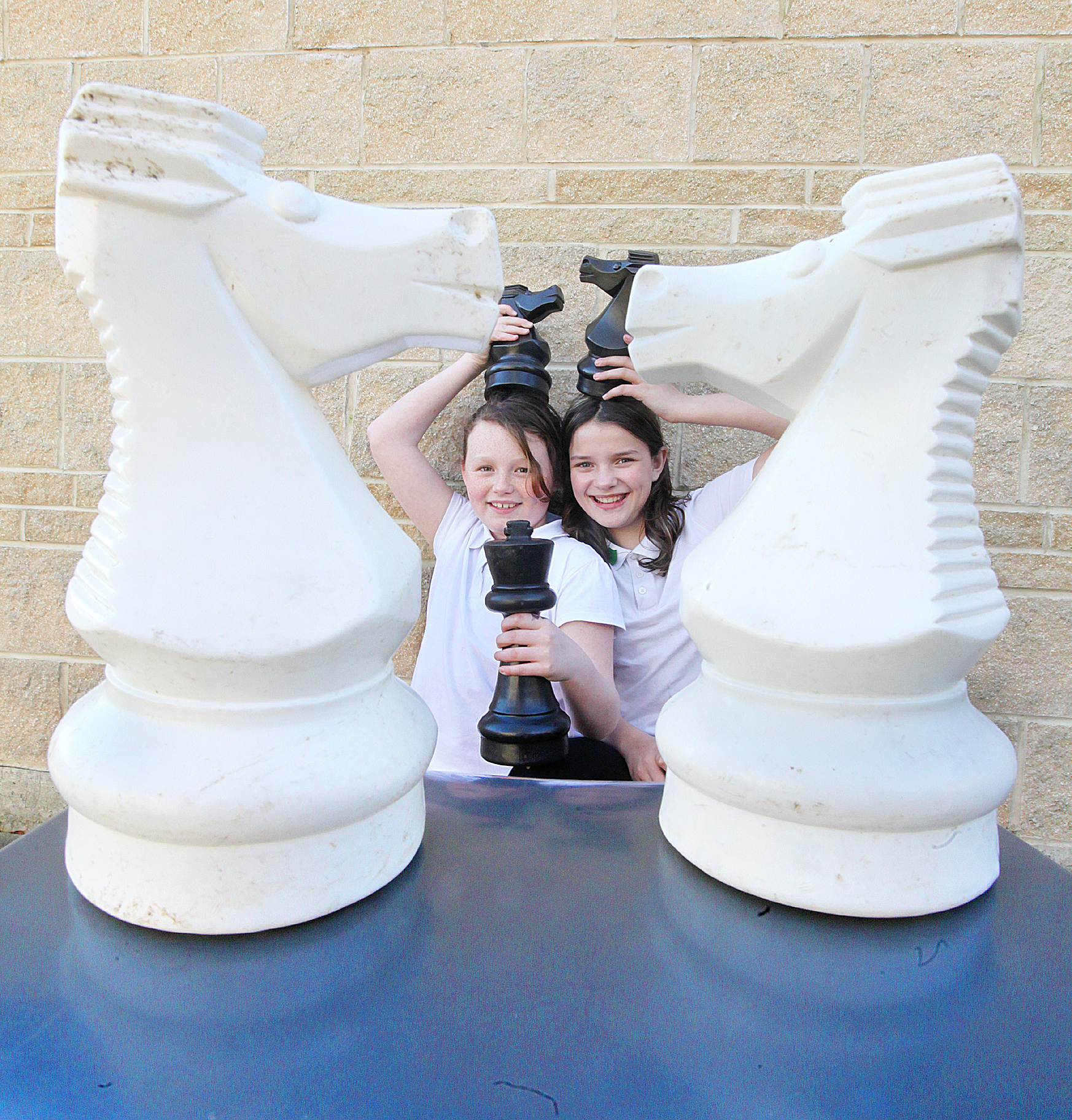 Glusburn pupils Sophie Nelson and Rebecca Sharp with some giant chess pieces