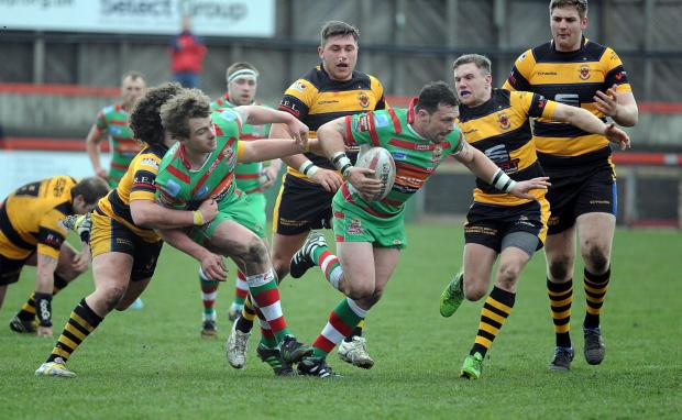 Keighley News: Ash Lindsay, centre, faces a lengthy spell on the sidelines with a broken leg