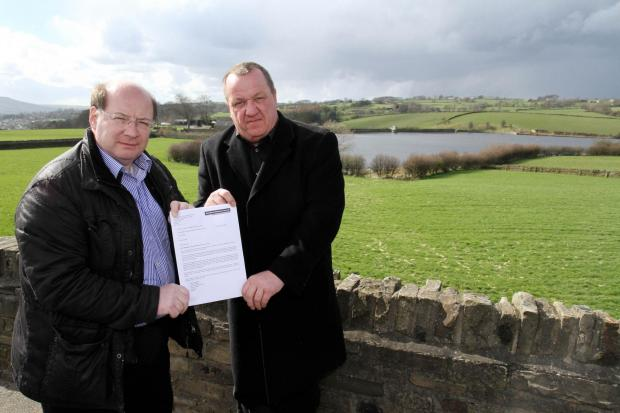 Councillor Adrian Naylor, left, and Silsden mayor Councillor Chris Atkinson, with the  letter from Bradford Council warning of the risk of flooding