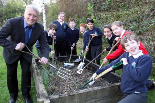 Councillor Andrew Mallinson joins members of Steeton Primary School's gardening club after the award of a grant to the school