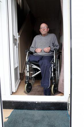 Amputee John Duffey at his home in West Lane, Keighley, where he is facing a long wait for adaptations which mean he can get out of the house on his own