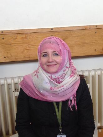 South Craven School teacher Samantha Batch tries out a headscarf during an Asian bazaar organised by pupils