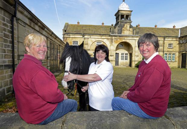 Louise Forbes, centre, of the Yorkshire Building Society, with, from left, Barbara Chuter and Barbara Bostock, with one of the horses at Riding for the Disabled at the St Ives estate in Harden
