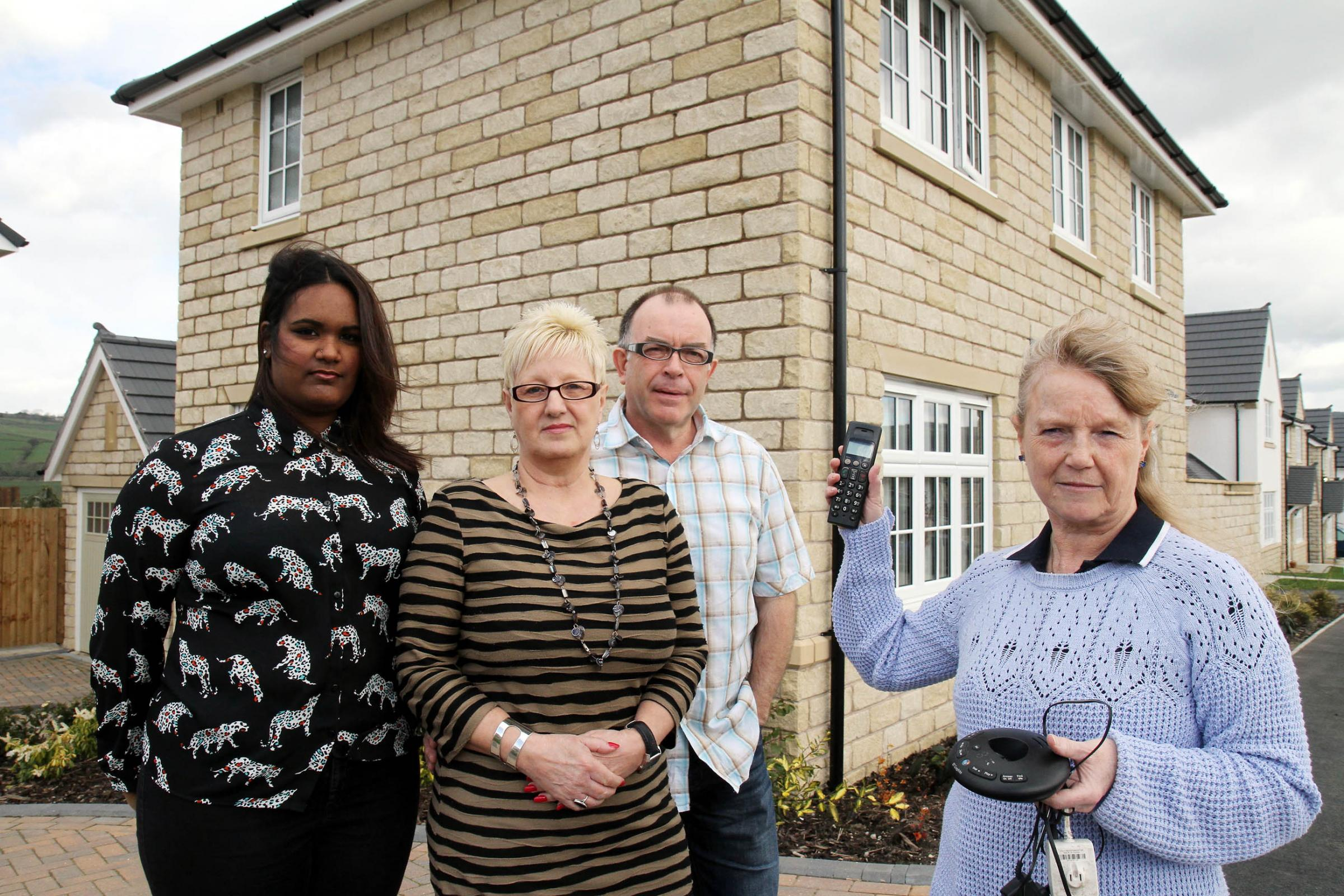 Residents of Meadow Drive in Steeton, from left, Devika Mohammed, Diane Hall, David Hall and Vayle Sherriffs, who have been left without a phone service