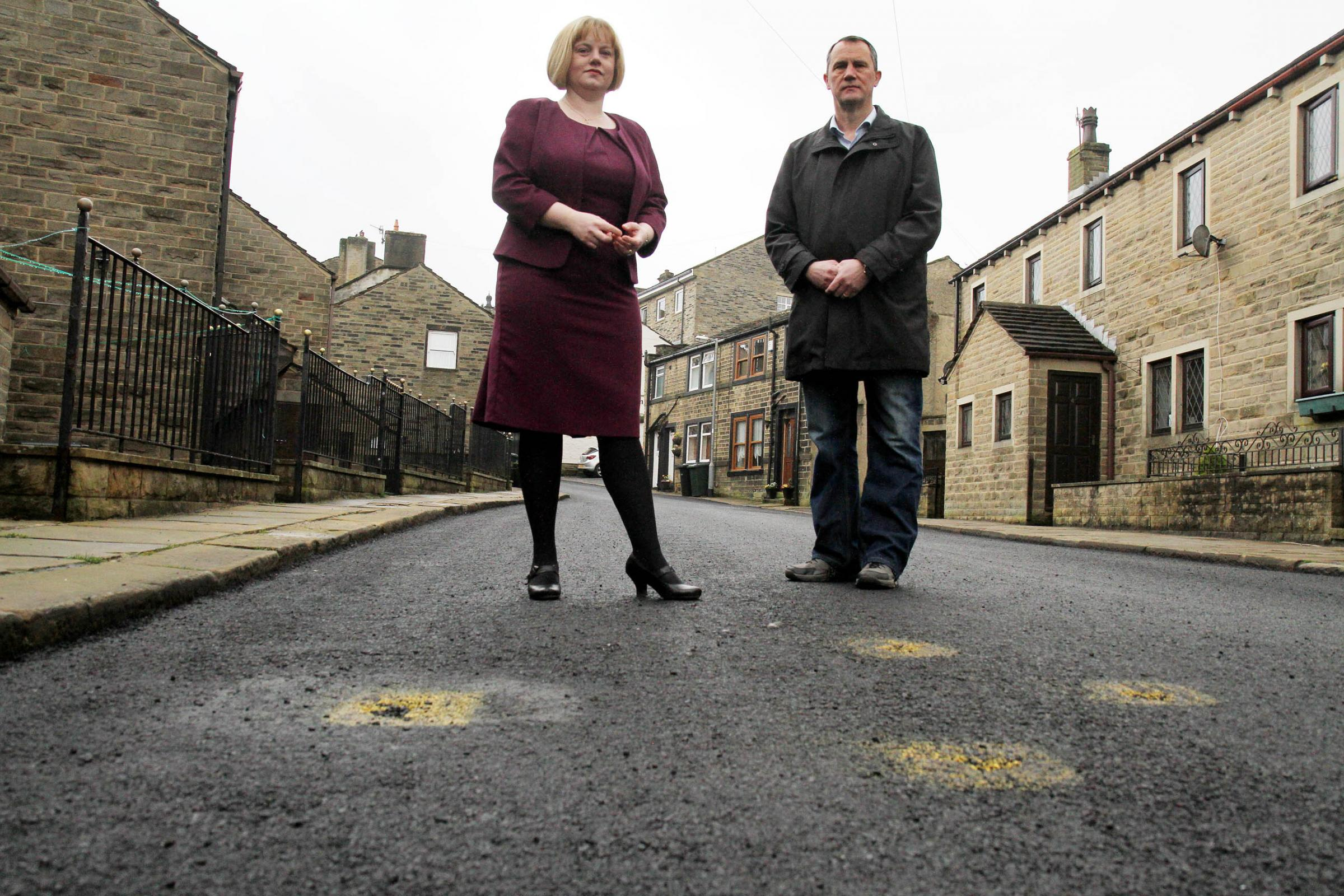 Councillors Rebecca Poulsen and Glen Miller in Changegate, Haworth, which has already been marked for repairs after recent resurfacing work was carried out