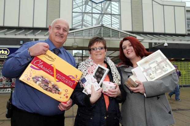 Keighley News: Airedale Shopping Centre manager Steve Seymour presents prizes to Keighley News Mother's Day competition winner Julie Dunford and her daughter, Lee-anne Harvey