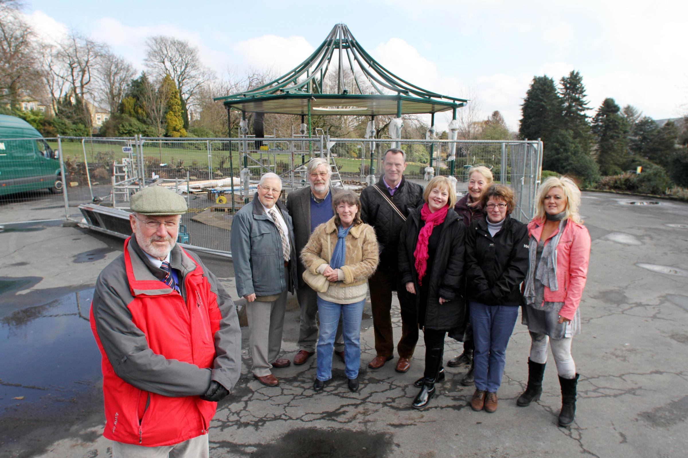 Haworth Parish Council chairman, Councillor John Huxley, left, is joined by fellow members and Friends officials as work begins on the Central Park bandstand in the village