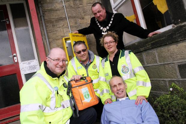 St James's Church priest the Reverend David Griffiths by the new defibrillator box with community first responders, from left, Ray Bolton, Simon Hunt, Sara Smith and Silsden mayor Councillor Chris Atkinson
