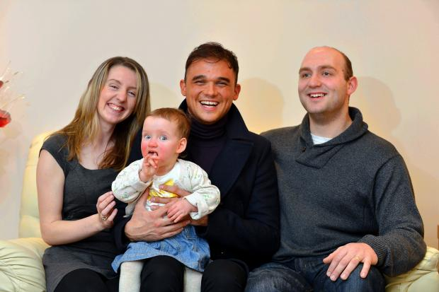 Singing star Gareth Gates cuddles little Nicole Vendettuoli, sat next to the baby's proud parents Candice and Tom