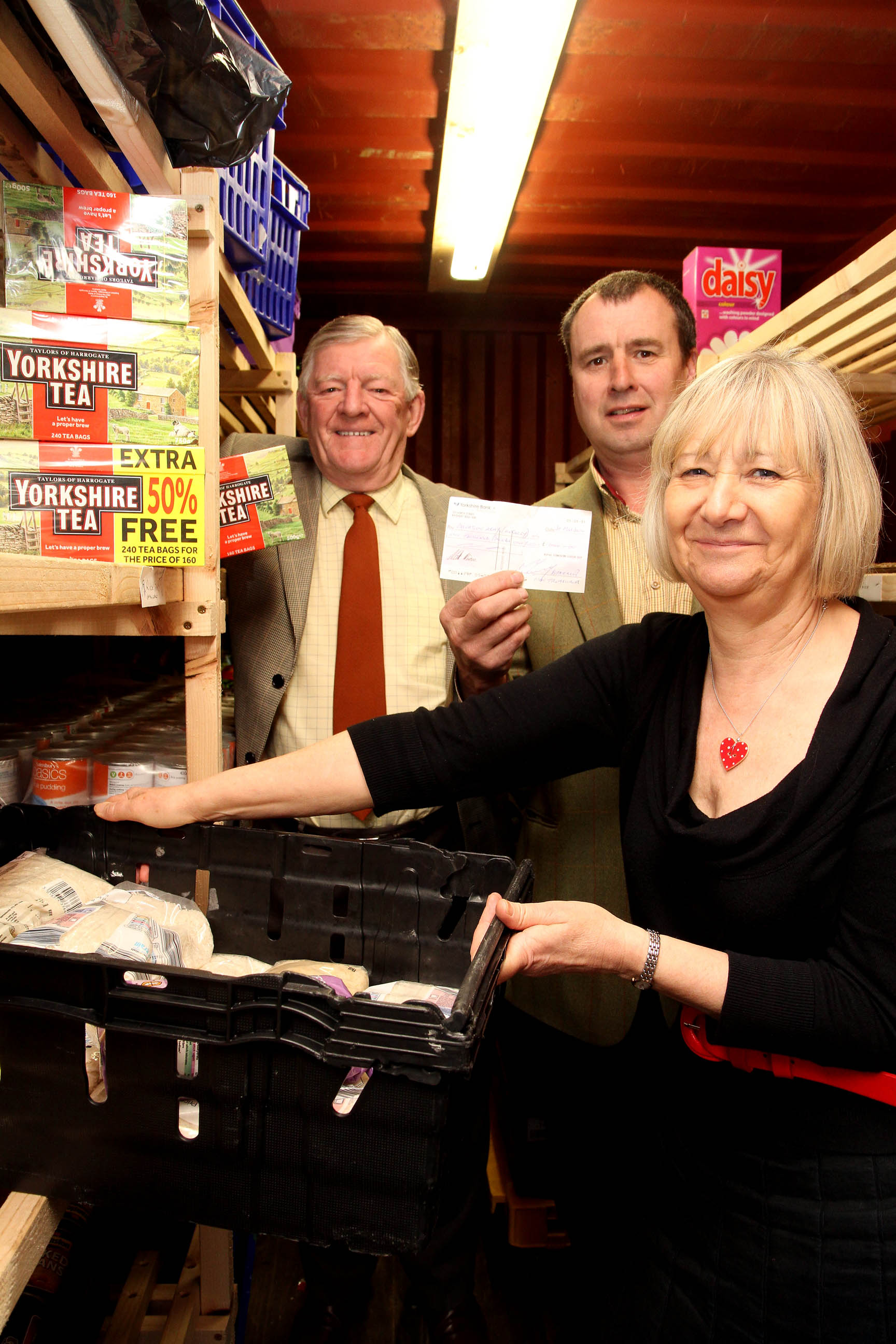 Chris Bown (right) of Keighley Salvation Army, receives £1,000 for the church's foodbank from Royal Yorkshire Lodge social secretary, David Paley (left) and worshipful master Chris Rushton