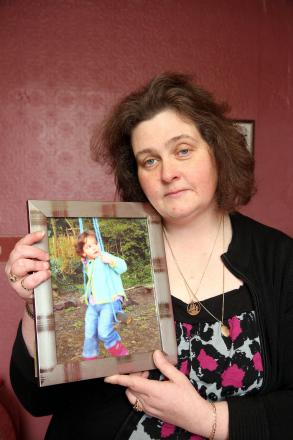 Andrea Walker holding a picture of her daughter, Ellie, who died aged three