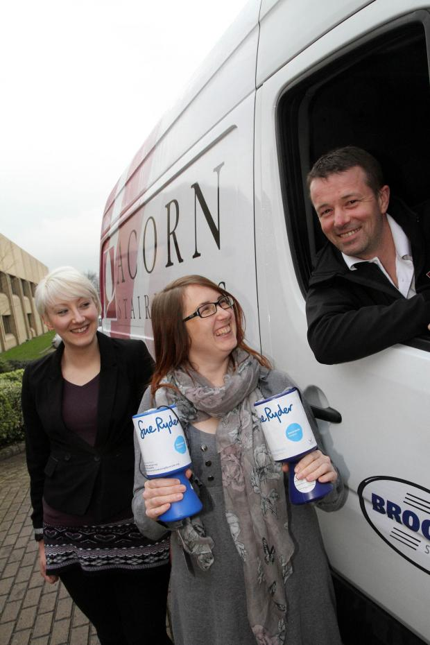 Keighley News: ue Ryder regional fundraising manager Hannah Taylor, centre, joins Acorn Stairlifts' European installations manager Georgie Chester and installation engineer Anthony Neild to thank the company for putting in a stairlift at the home of a Manorlands patie
