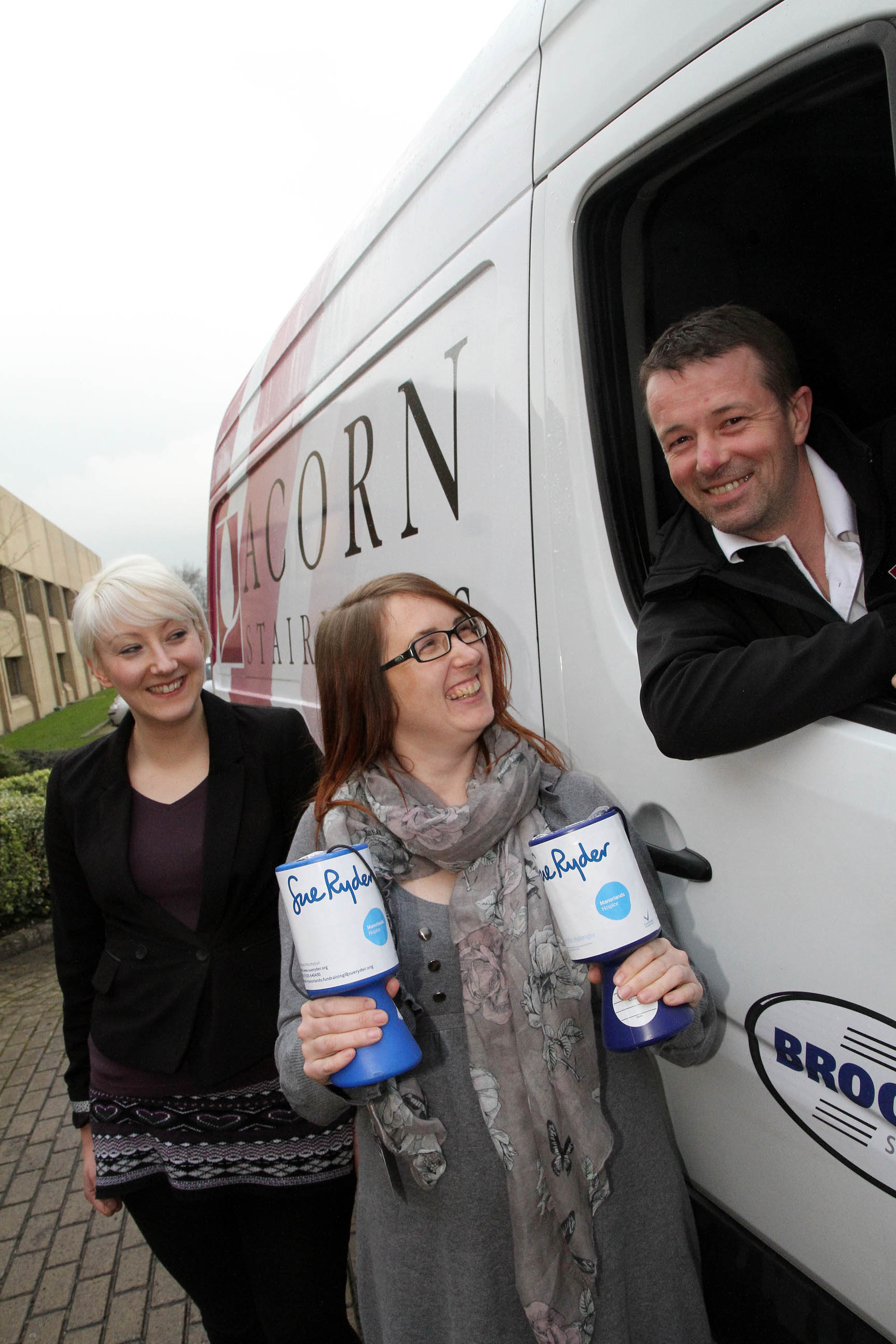 ue Ryder regional fundraising manager Hannah Taylor, centre, joins Acorn Stairlifts' European installations manager Georgie Chester and installation engineer Anthony Neild to thank the company for putting in a stairlift at the home of a Manorlands patie