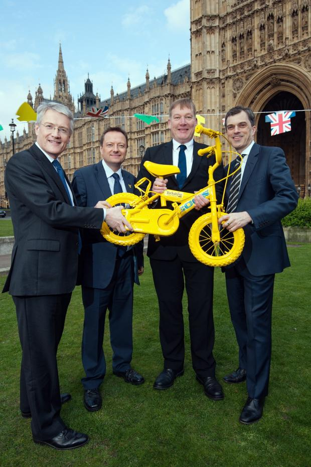 Keighley News: MPs celebrating the 100-day countdown to the Grand Depart include Kris Hopkins, second right, and Julian Smith, right