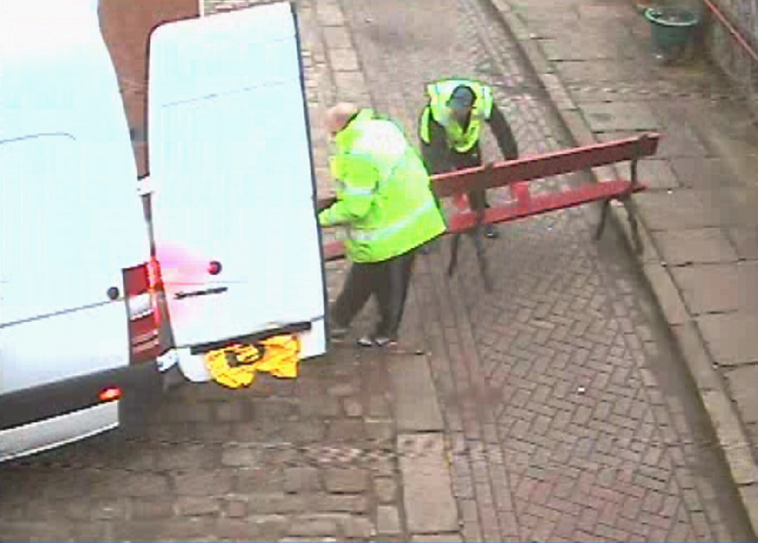 CCTV images of the benches being stolen from the station