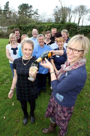 Manorlands' palliative care services manager Lizzie Procter (right) toasts hitting the fundraising target with some bubbly for staff, fundraisers and volunteers