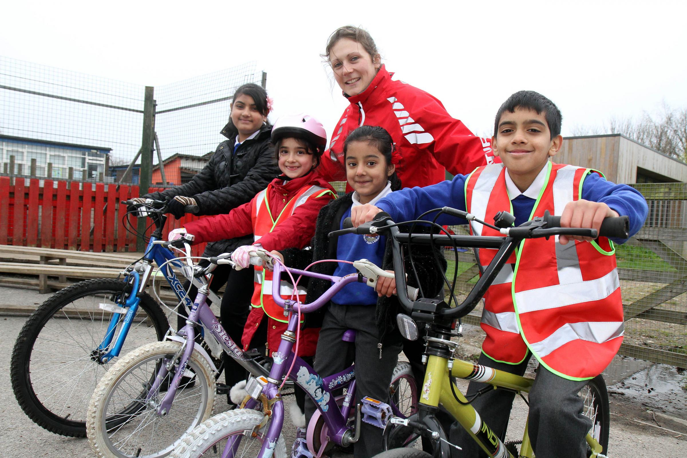 Joining in the cycling session with Emily Groves, of Sustrans, are St Mary's Primary School pupils (from left) Sanya Adrees, Sophie Newton, Mahdiya Khan and Ibrahim Nazir