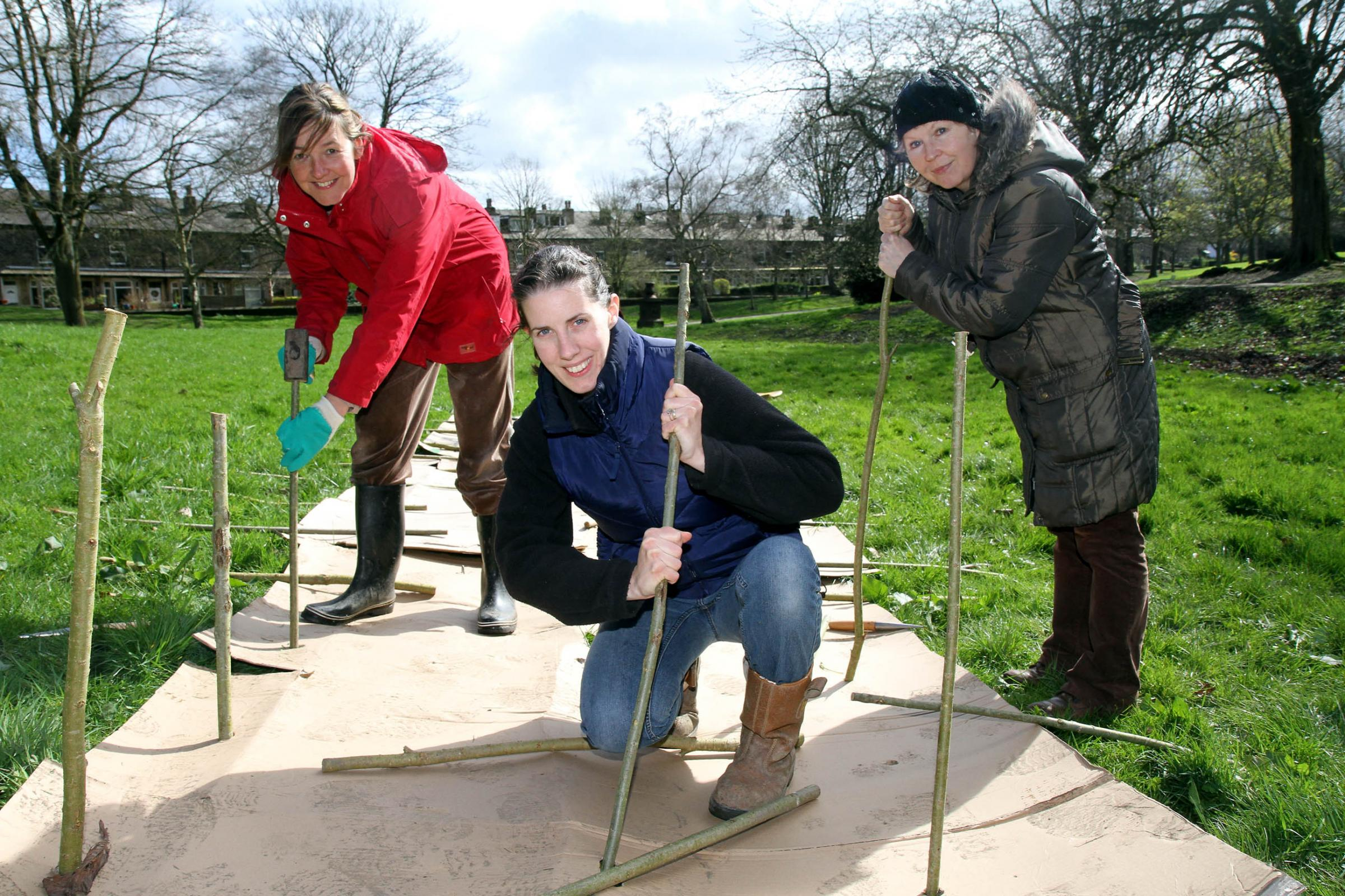 Joining in the willow planting at Keighley's Lund Park are (from left) Jo Horrox, Pippa Chapman and Linda O'Connor