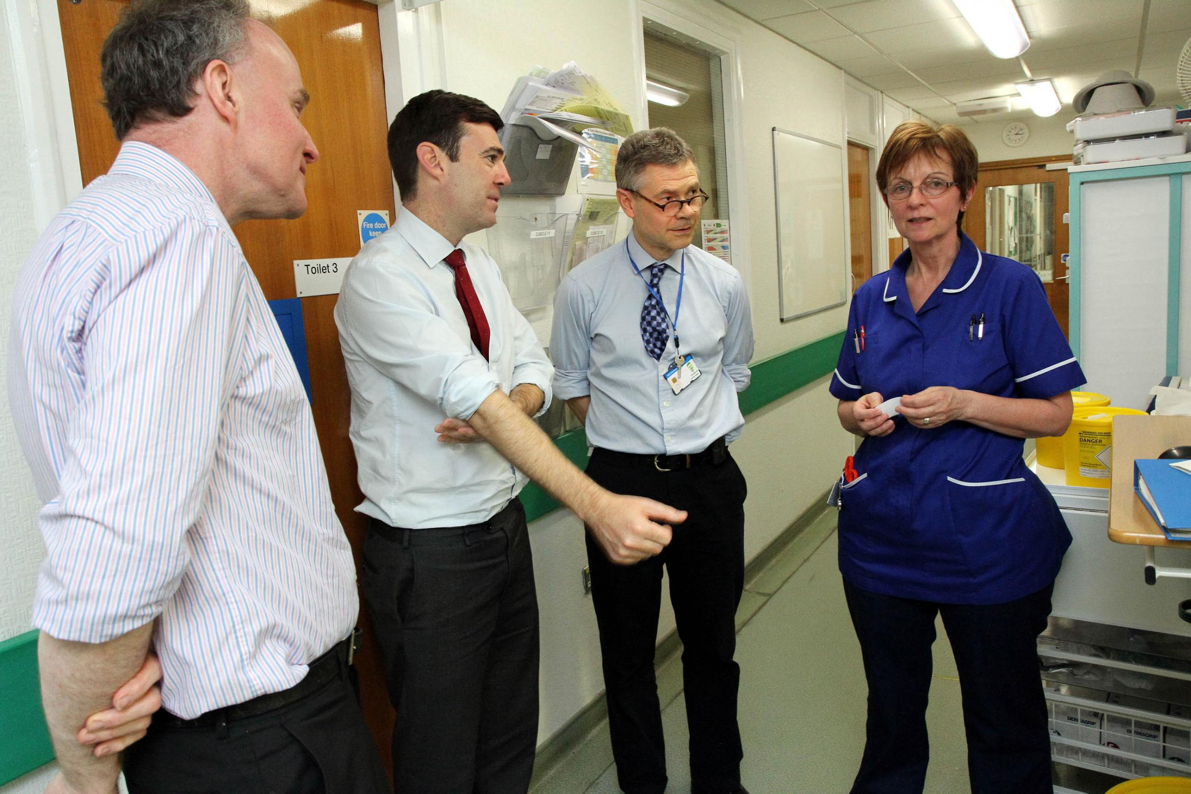 Labour's prospective parliamentary candidate for Keighley John Grogan, left, joins shadow health secretary Andy Burnham as he talks to A&E nurse Jane Howling and interim medical director Dr Harold Hosker, third from left, during his visit to Airedale Ho