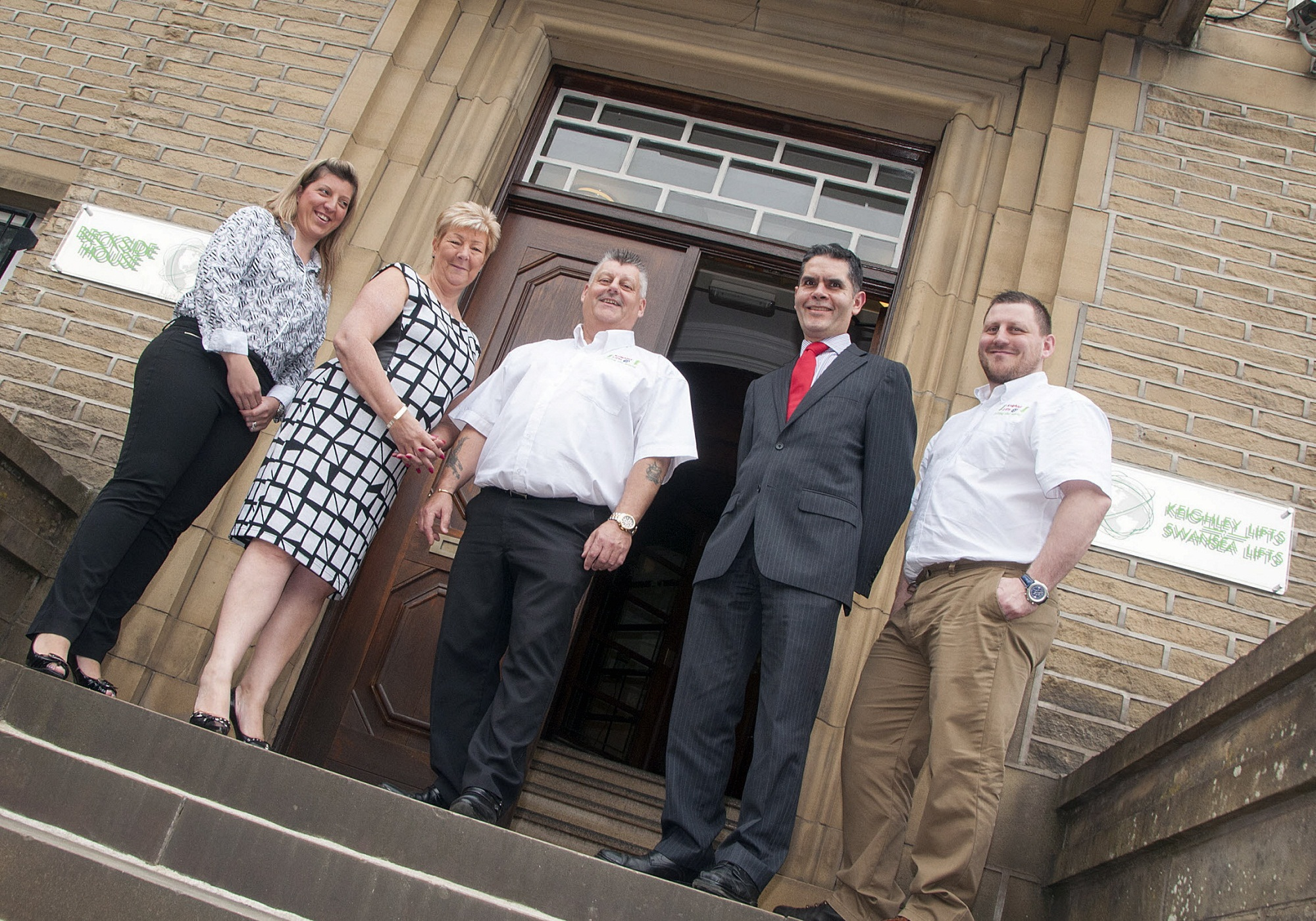 Keighley Lifts managing director, Stuart Boocock, centre, with Ben Cutts, of Lloyds Bank Commercial Banking, and, from left, his daughter, Rebecca Boocock-Wilson, wife, Isabel, and son, Garry Boocock