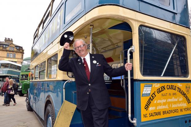 Volunteer conductor Bernard Dalby doffs his cap to visitors during Keighley Bus Museum Trust's Metro anni
