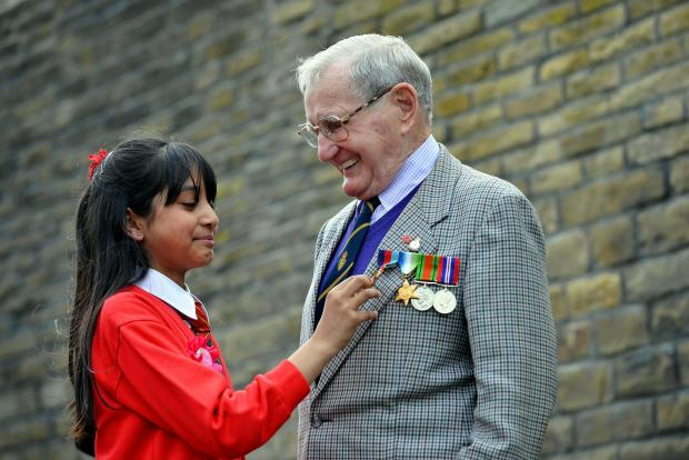 Allerton pupil Ayshah Ahmed, who was celebrating her tenth birthday, with Edgar Bottomley