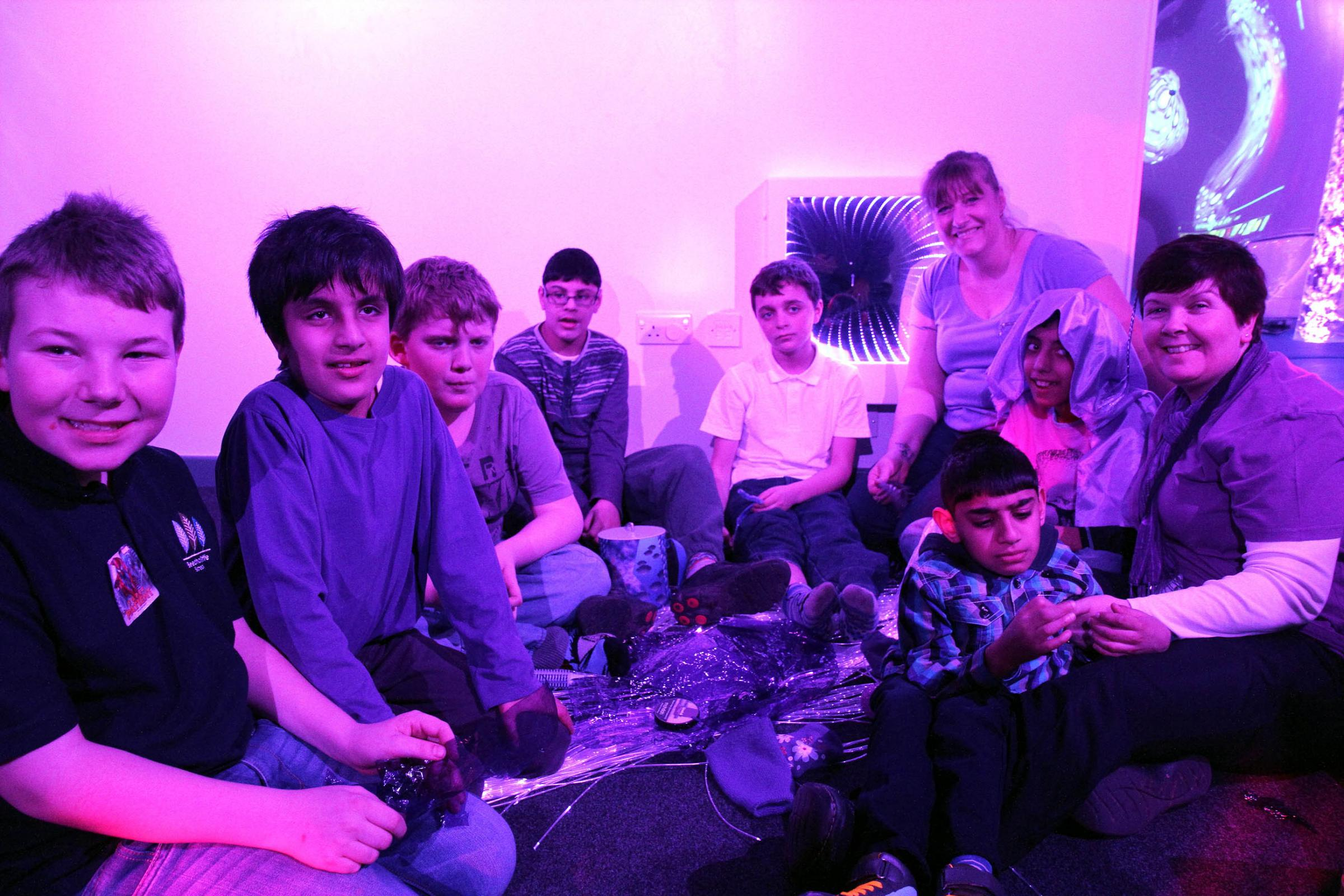 Beechcliffe School class one students and staff join in the purple-themed epilepsy-awareness day activities in the sensory room raising £200