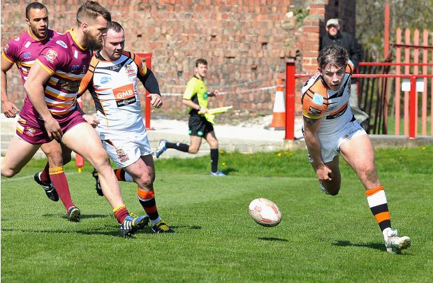 Keighley News: Lewis Graham touches down for Cougars in their 29-20 defeat at Batley