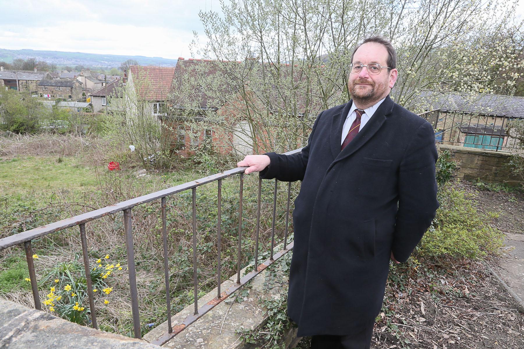 Councillor Keith Dredge at the site next to Utley Cemetery, where approval has been given for new houses to be built